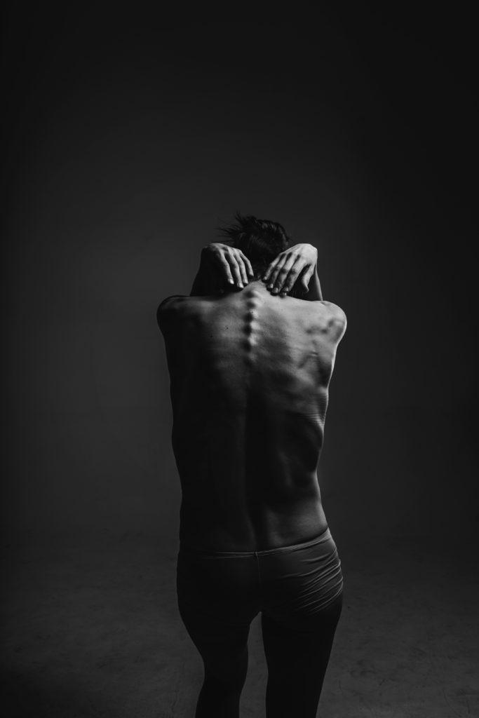 Bad posture of a skinny woman